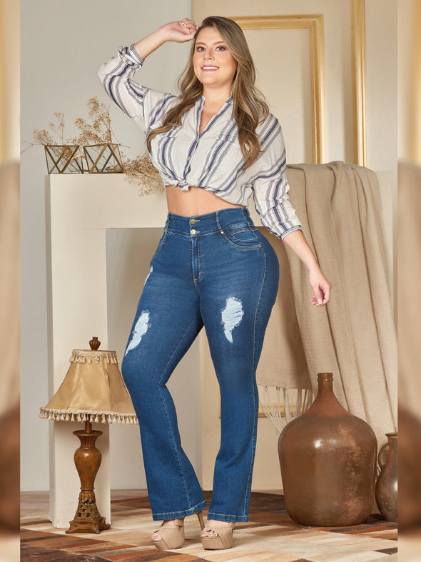 plus size colombian model distressed with white stiped blose and nude heels