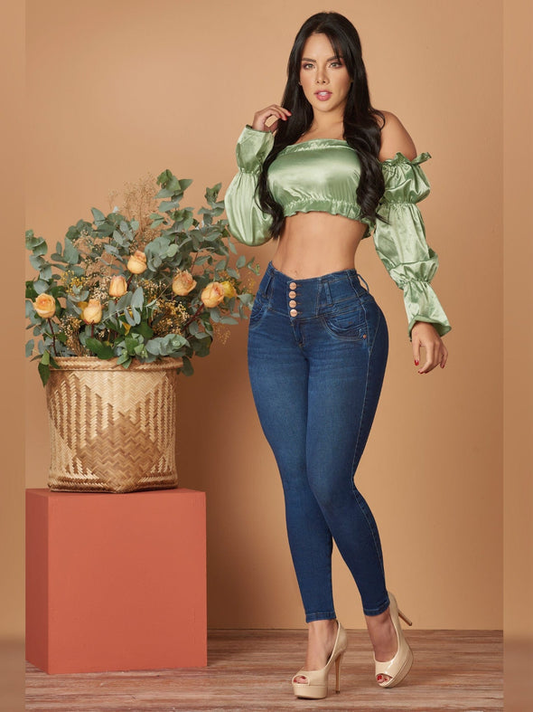 emerald green crop top dark blue jeans tummy control and nude high heels