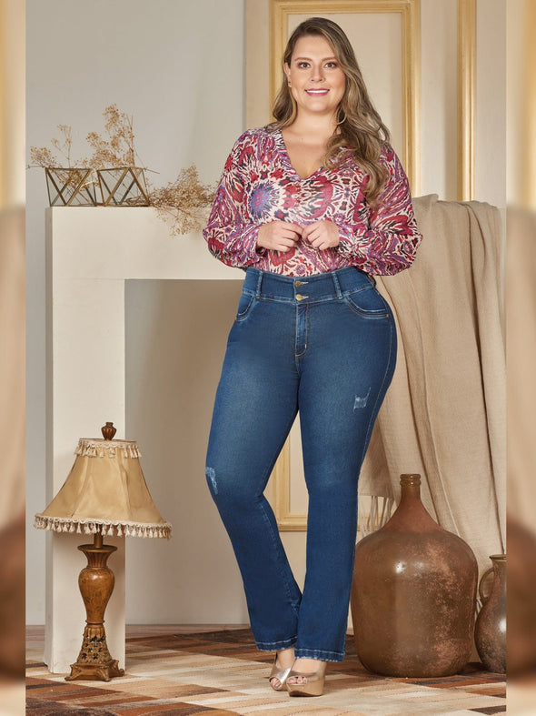 plus size colombian woman with blouse and boot cut jeans