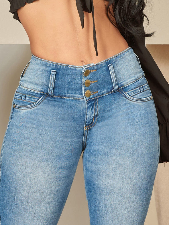 up close view three button high waist skinny jean