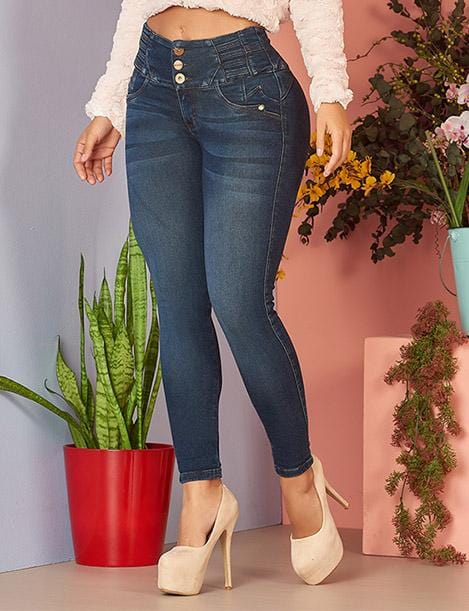 medium wash skinny jeans with three buttons up close with high heels