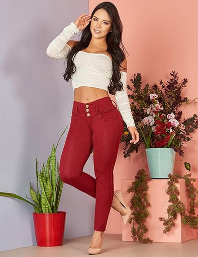 colombian woman wearing white crop top and maroon colombian three button skinny jeans