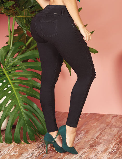 back view of black butt lift denim jeans with green high heels
