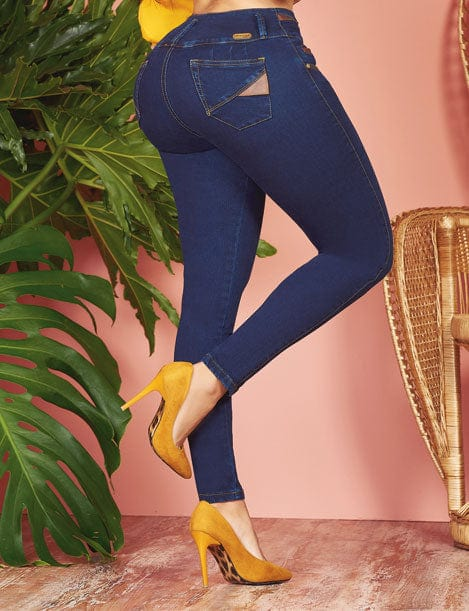back view of colombian contour jeans with butt lift and high heels