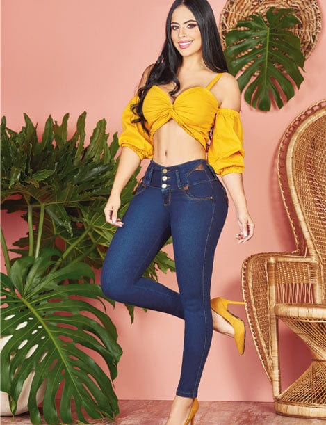dark blue colombian jeans with brown details and mustard crop top and heels