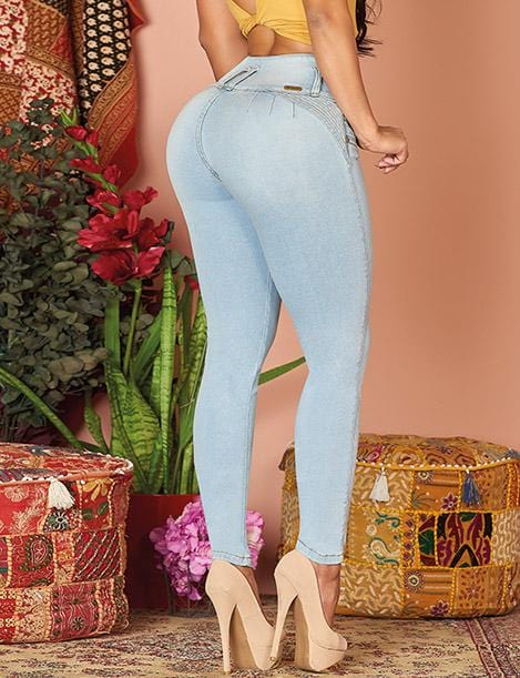 butt lifter jeans light wash skinny jeans with nude heels and colorful background