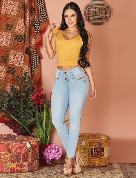 colombian dark hair woman with yellow mustard top and light blue butt lift jeans