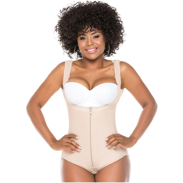 black afro latina with hands on hips wearing vest faja bodysuit shaper with hands on hands
