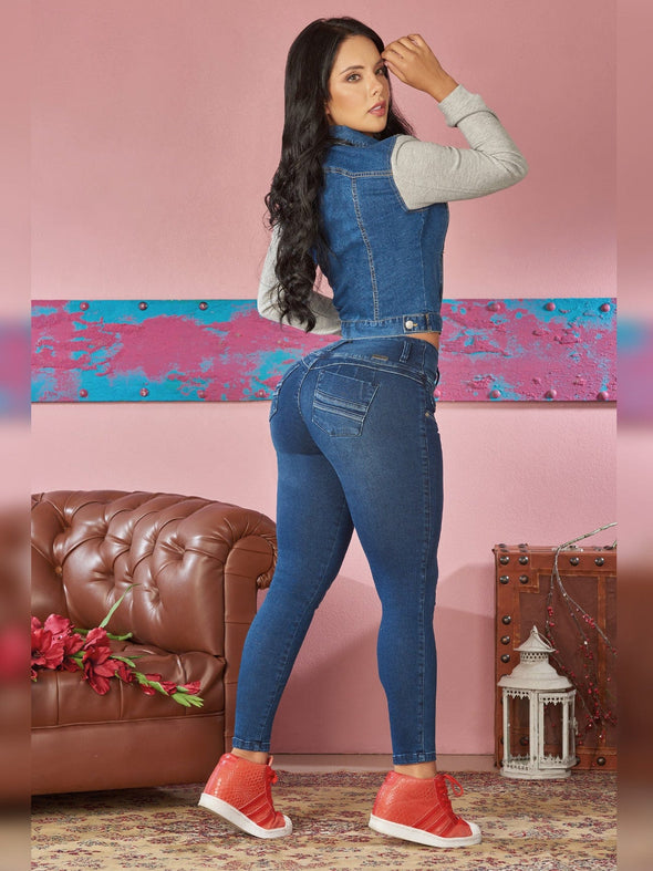 colombian woman wearing dark skinny jeans  butt lift red sneakers denim jacket