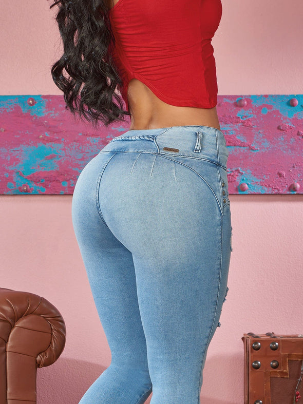 up close view light wash colombian butt lift jeans no pockets red crop top