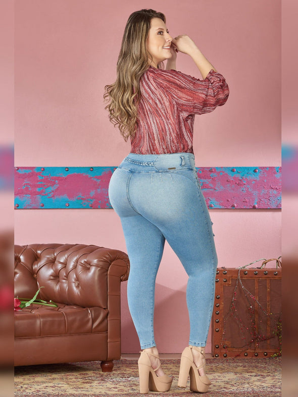 back view colombian jeans skinny fit light wash colorful blouse nude high heels