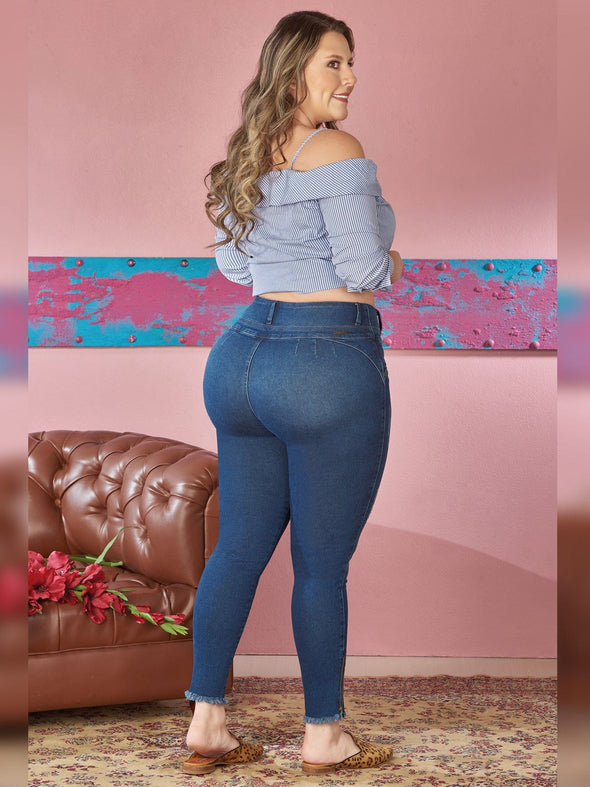 back view plus size colombian wearing blue skinny jeans with off shoulder stripe crop top