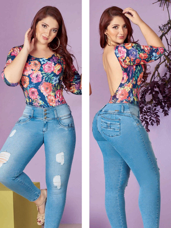 plus size colombian woman with floral top and blue distress jeans
