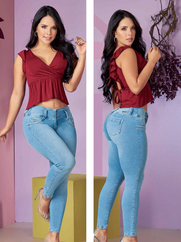 colombian woman wearing light wash blue jeans butt lift and maroon top