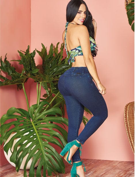 back view of colombian woman with blue halter top and butt lift colombian jeans and turquoise heels