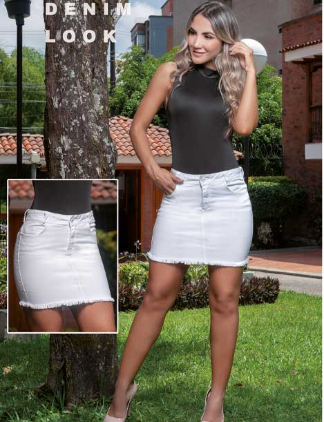 colombian woman with blonde hair wearing white denim skirt and olive bodysuit