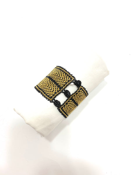 BLACK AND GOLD CHEVRON PATTERN WITH TWO CROSSES