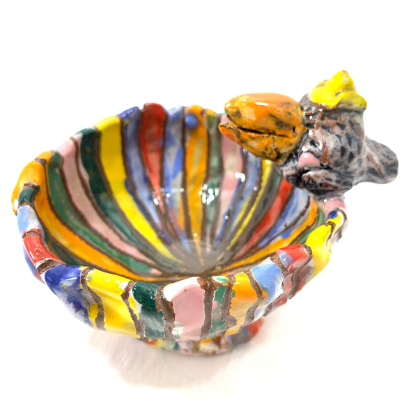 STRIPED BOWL WITH ORANGE BEAKED, YELLOW-HATTED BIRD