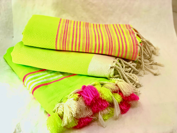 NEON TOWEL WITH PINK POMPOMS