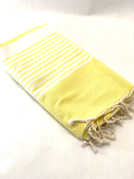 YELLOW TOWEL WITH WHITE STRIPES AND FRINGE
