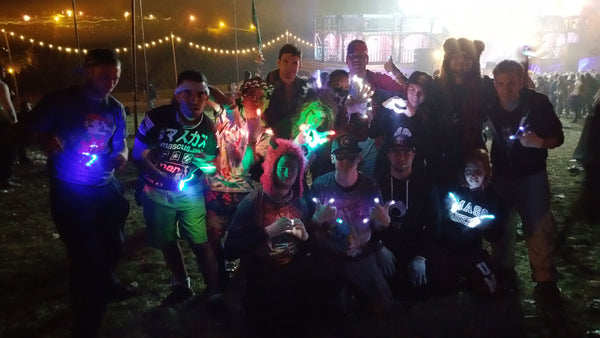 group of ravers at event with led gloves and light toys