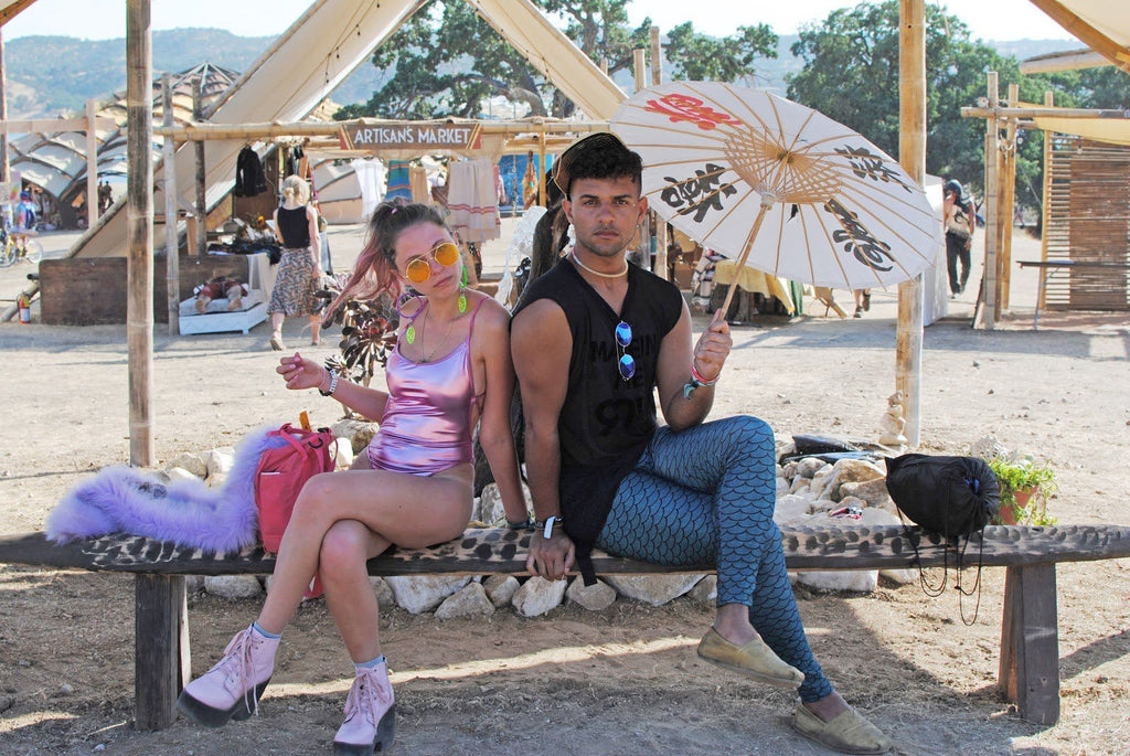 Girl in Pink Holographic Bodysuit with Neon Pink Combat Boots and Guy in Blue Mermaid Leggings during Lightning in a Bottle Music Festival