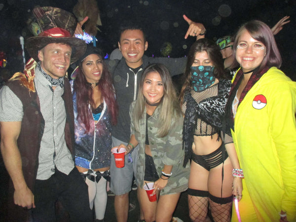 rave group enjoying nocturnal wonderland together