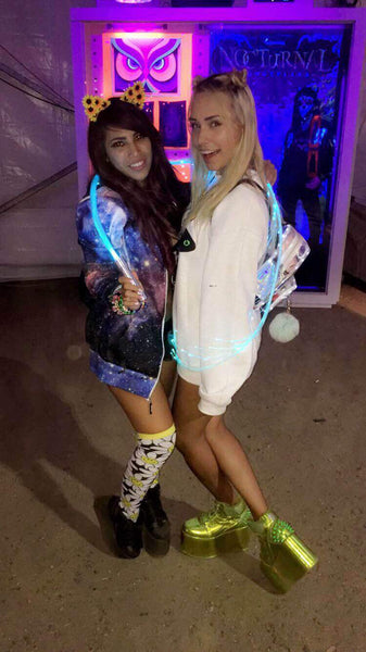 rave girls enjoying nocturnal wonderland together