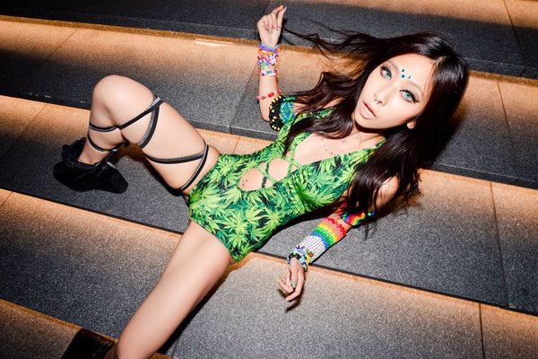 rave girl wearing marijuana bodysuit