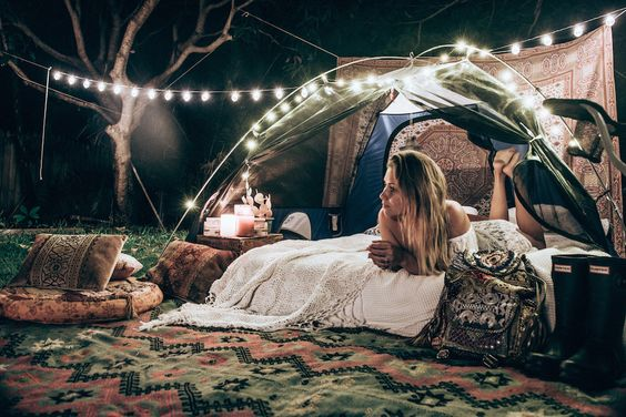 rave girl enjoying peaceful campsite setup