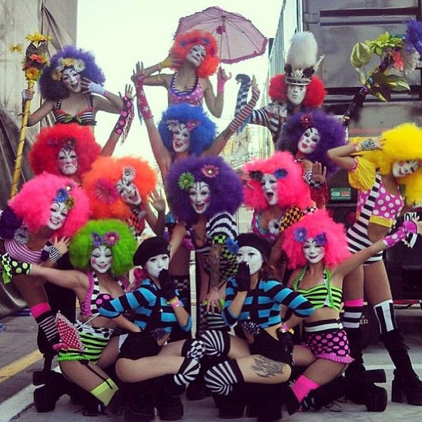 rave girls wearing colorful clown outfits