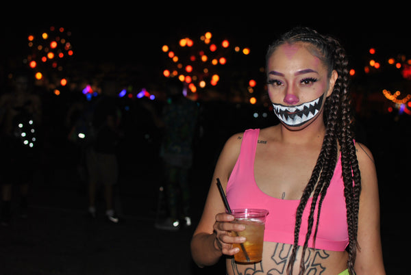 spooky rave girl wearing neon pink