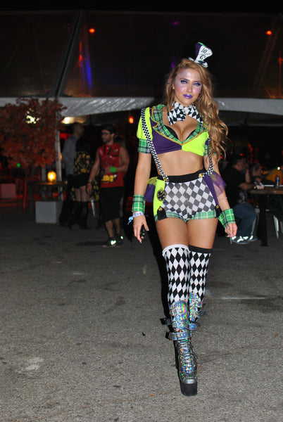 rave girl wearing mad hatter outfit