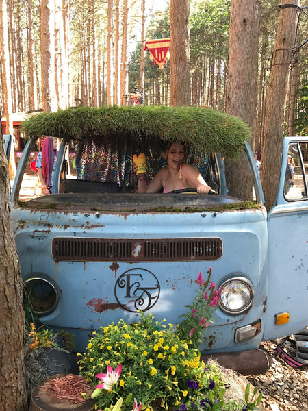girl in blue hippie van at Electric Forest