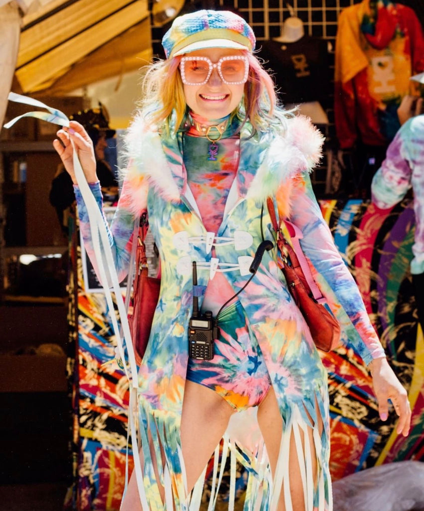 Tie Dye Inspired outfit with tie dye fringe duster, tie dye high waisted shorts and tie dye sheer bodysuit