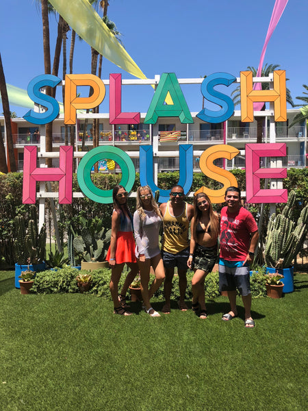 Squad hanging out in front of Splash House Sign