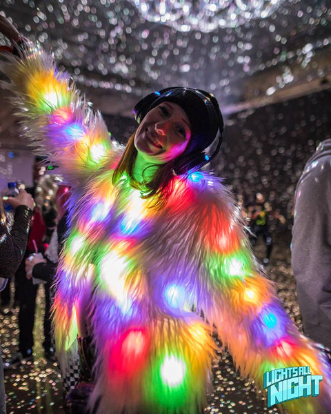 Girl wearing light up faux fur jacket from IheartRaves at Lights All Night Music Festival
