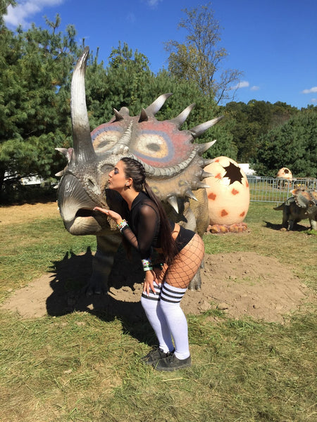 iHeart Raves rave girl in festival outfit at Lost Lands Festival 2017 with baby dinosaur