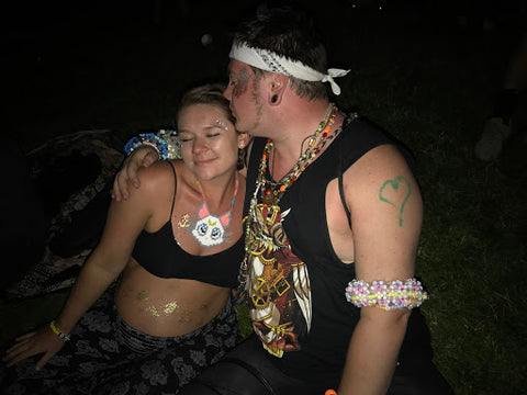 Raver Giving Fellow Raver a Kiss on the Head