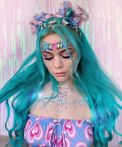 Raver with Turquoise Hair and Space Buns
