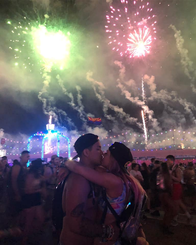 Ravers kissing under the fireworks at EDC