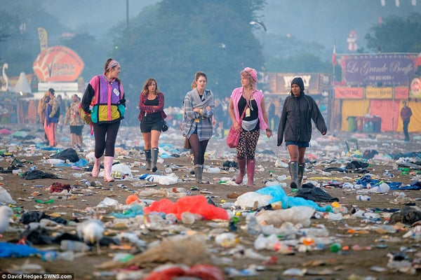 ravers walk through destroyed festival grounds