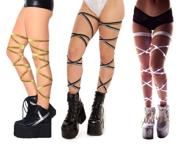 Gold glitter leg wraps, sparkly black and silver leg wraps, and white light-up leg wraps