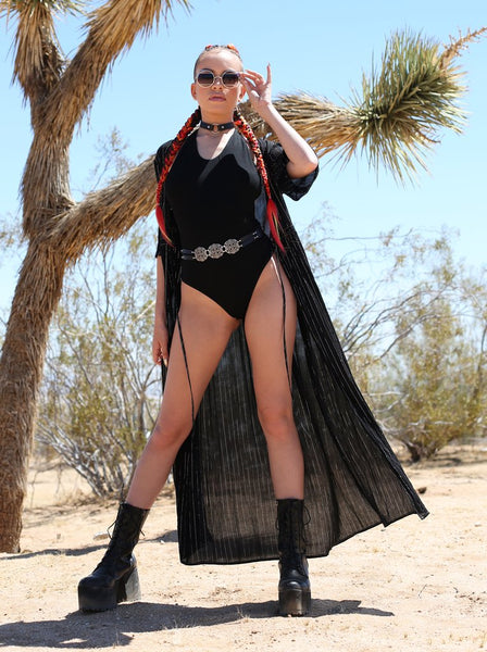 Girl in the desert wearing a Black Duster and Black Bodysuit