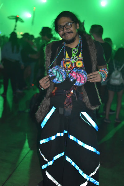 raver showing off his beaded necklaces