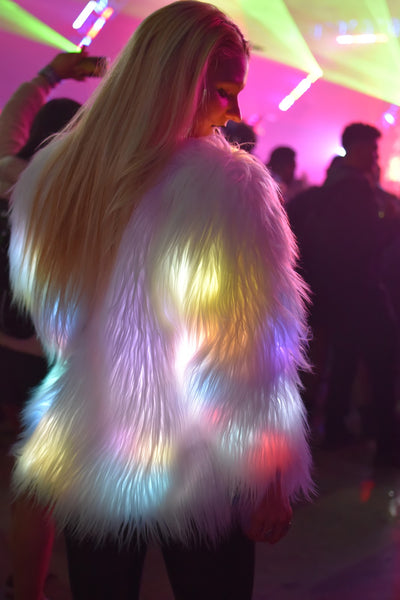 rave girl wearing white LED fluffy jacket