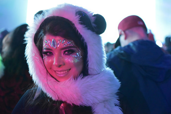 rave girl wearing panda hood and sparkly makeup
