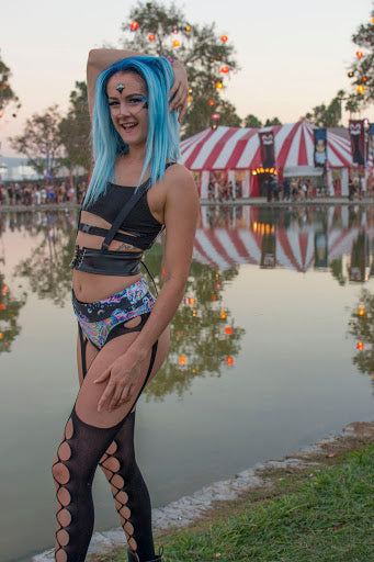 Raver with Blue Hair wearing black strappy top and trippy bottoms