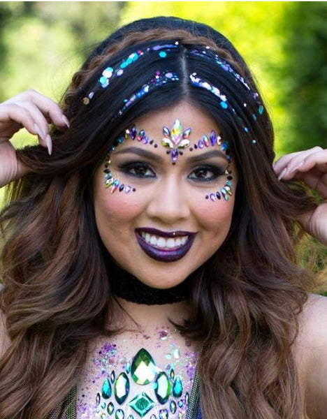 Raver Girl with Sparkly Glitter Strands in her hair and purple and green festival face gems