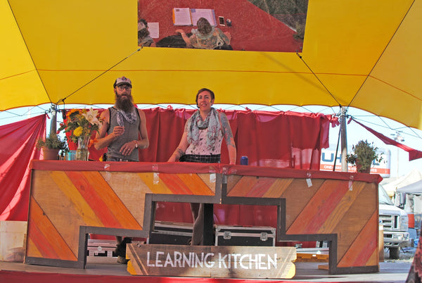 Guy and Girl at Learning Kitchen at Lightning in a Bottle Music Festival in Bradley, CA